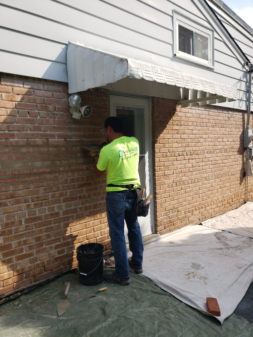 Highland Park, IL - Doing what we do best tuckpoint all house in highland park call us for free stimates