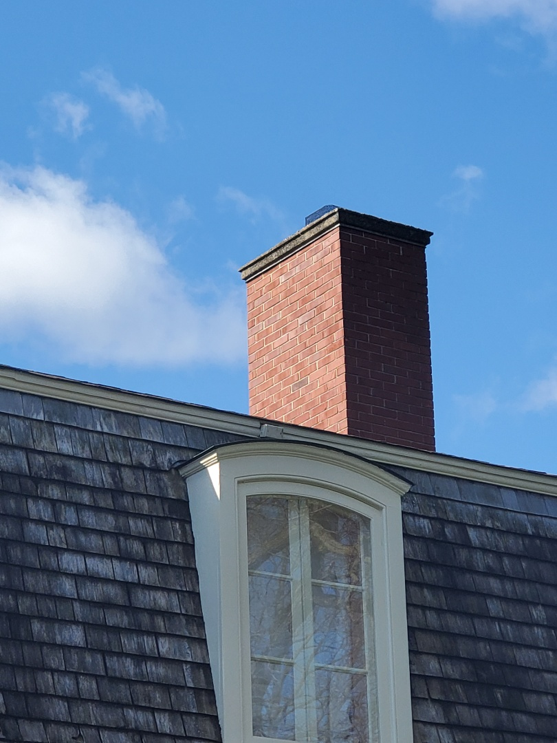 Libertyville, IL - Replace concrete cap to prevent water infiltration on this brick chimney.