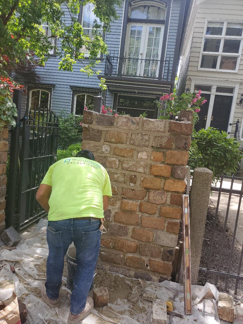 Chicago, IL - Rebuild stone wall call NSBW for any masonry repairs