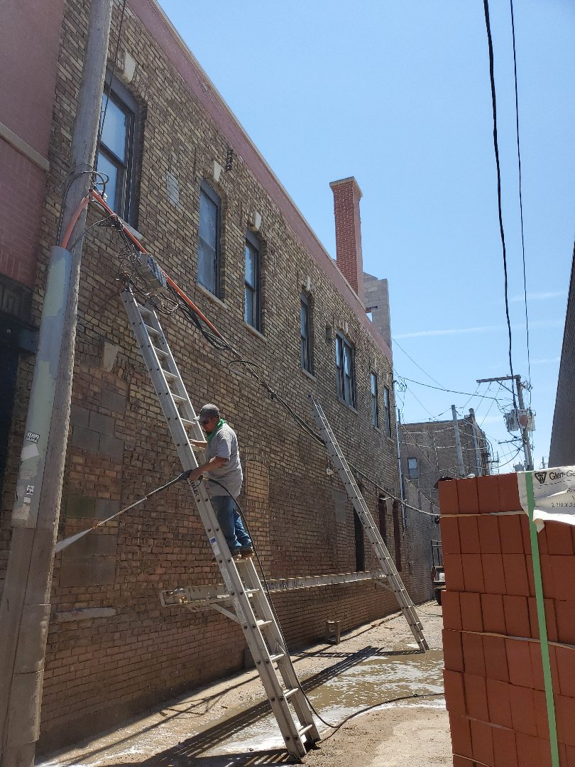 Chicago, IL - Restoration to a building tuckpointing,acid wash,new masonry walls call NSBW for your masonry needs
