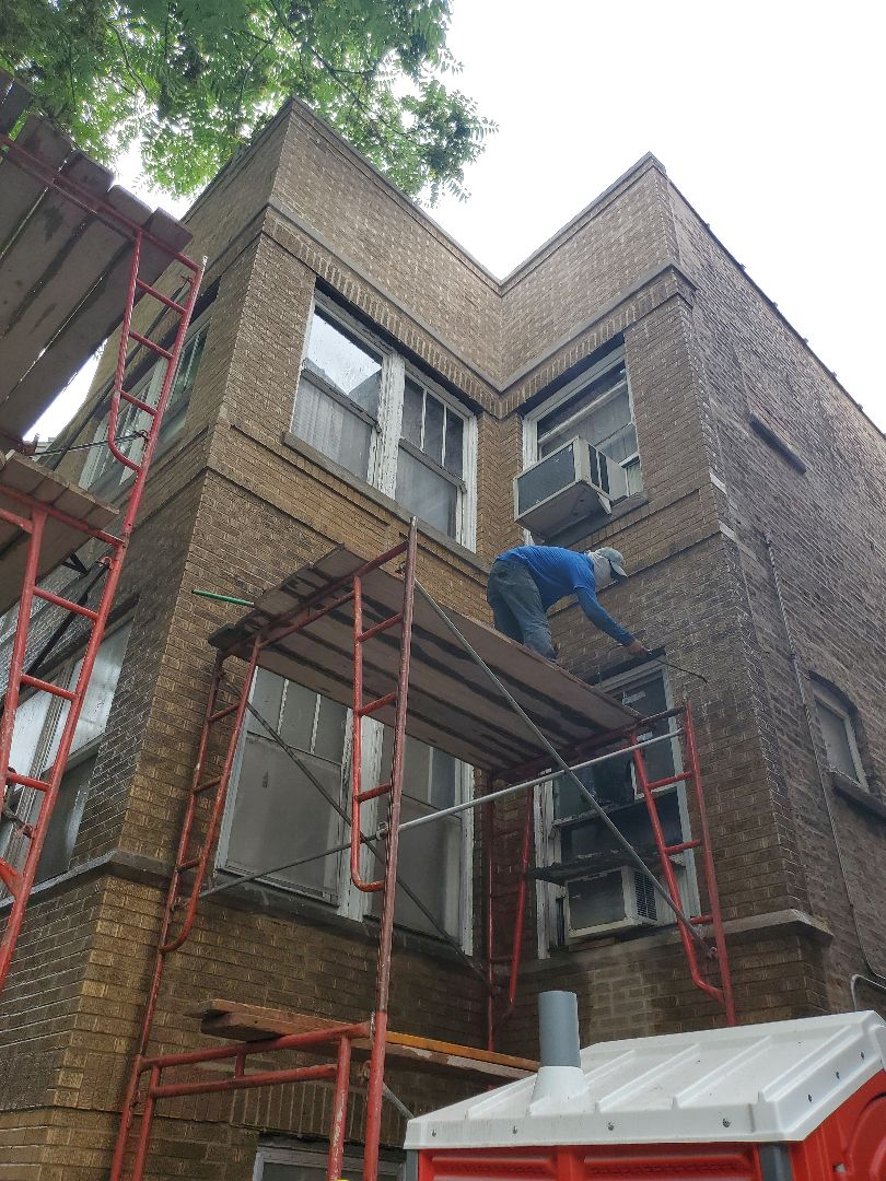 Chicago, IL - Restoration of brick color ,lintels and tuckpointing call us for any masonry needs