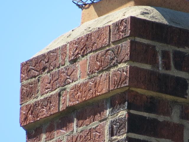 Kenilworth, IL - Water Infiltration caused by Ice Damming and insufficient chimney crown.