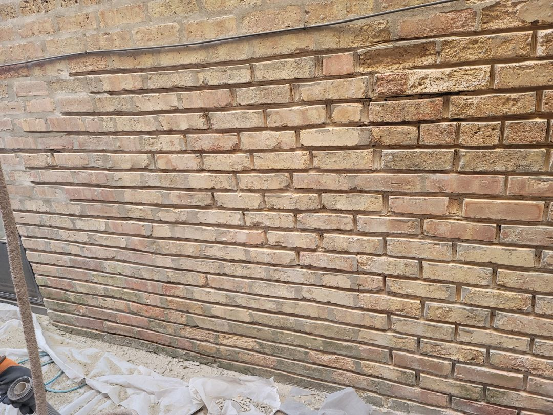 Chicago, IL - Grinding out, Tuck pointing and brick replacement.