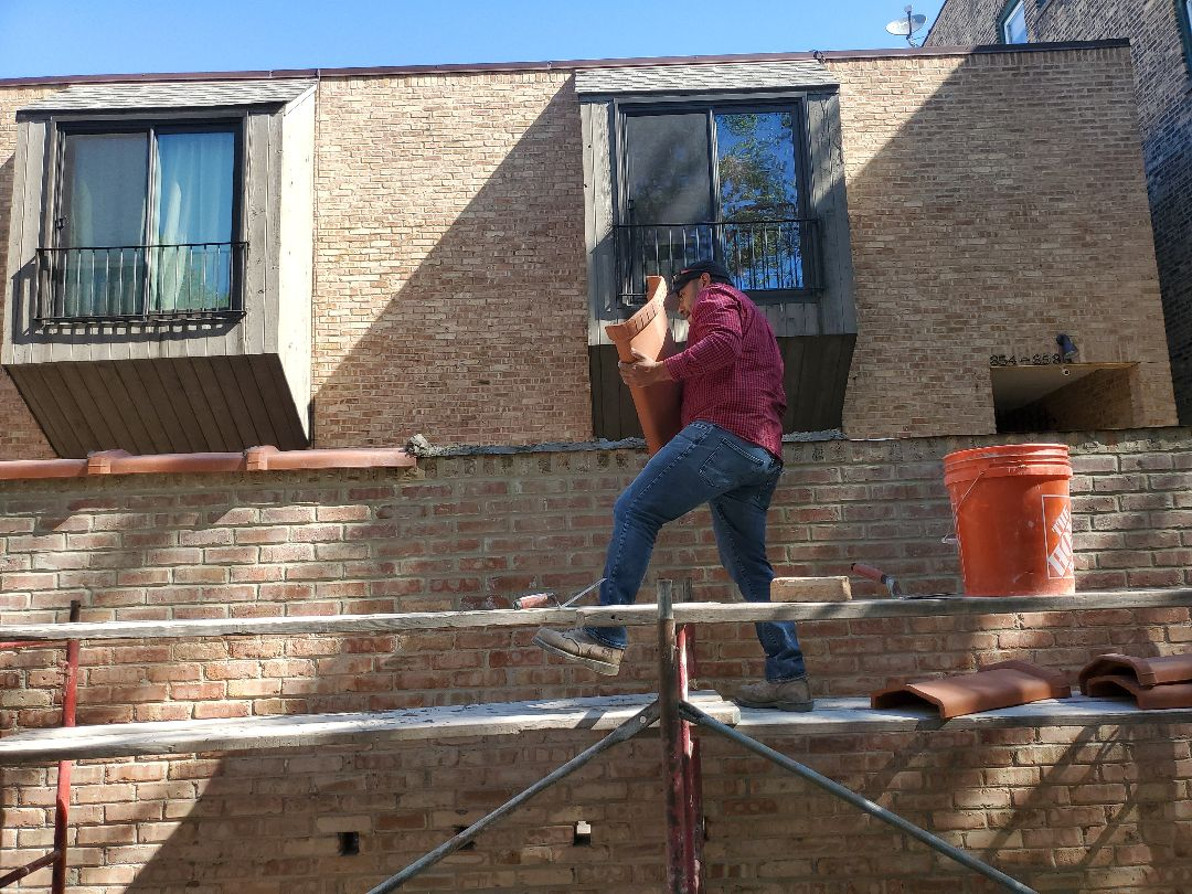 Chicago, IL - Installation of new flashing and coping to protect water infiltration call NSBW for any masonry repairs