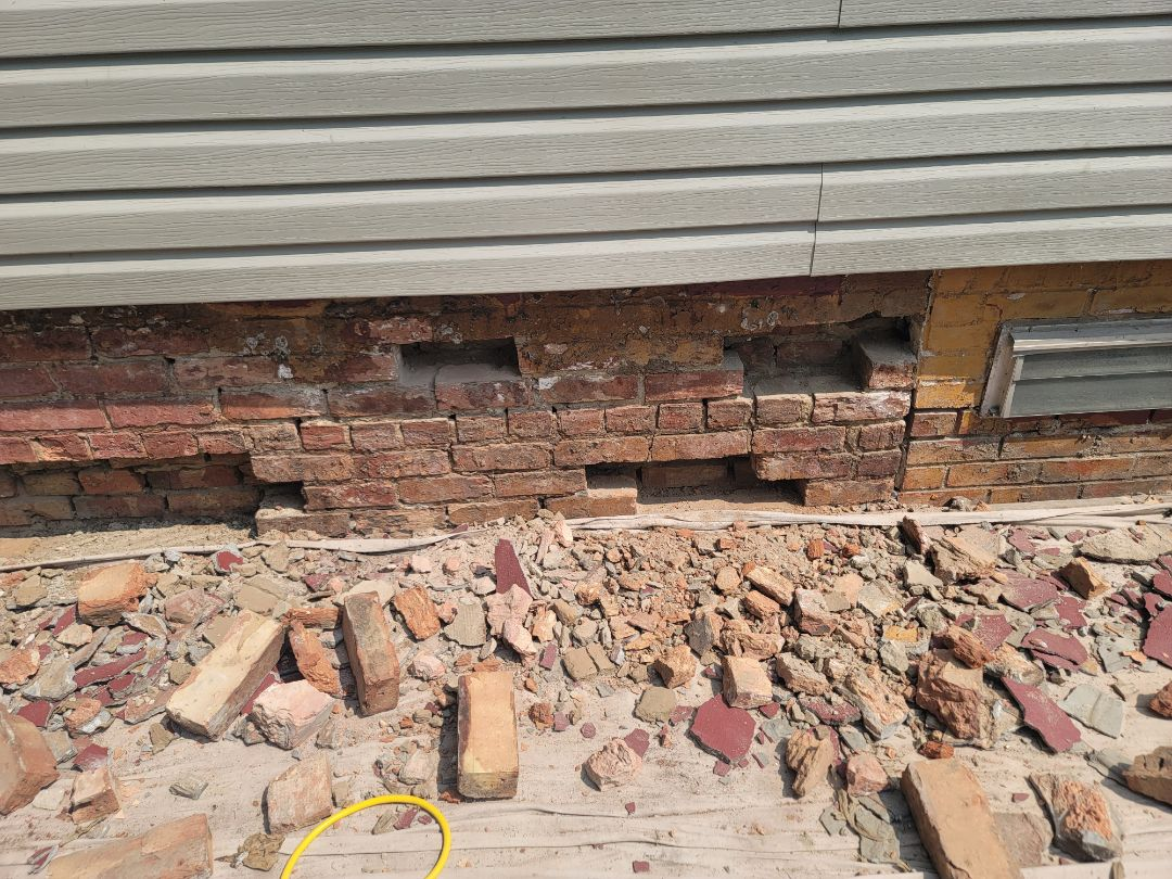 Brick replacement and Tuckpointing. Call North Shore Brickwork.  Lintels and limestone work.