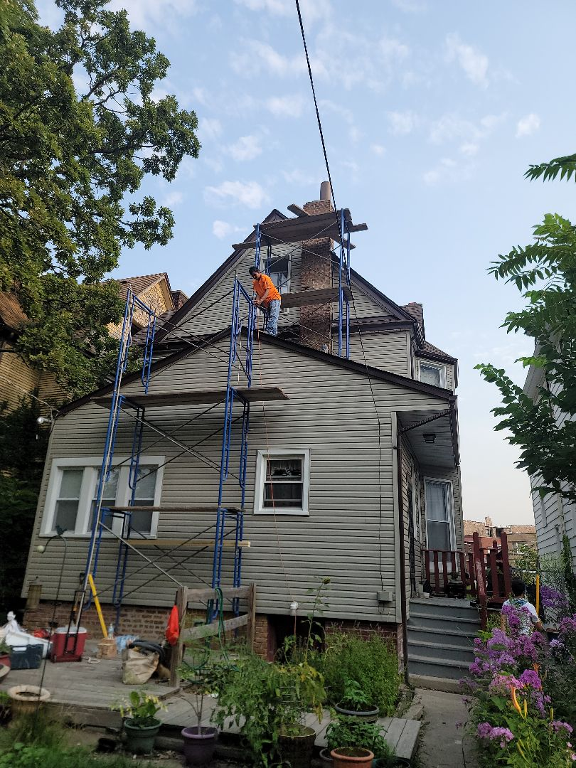 New chimney crown, Grind out and Tuck point by North Shore Brick