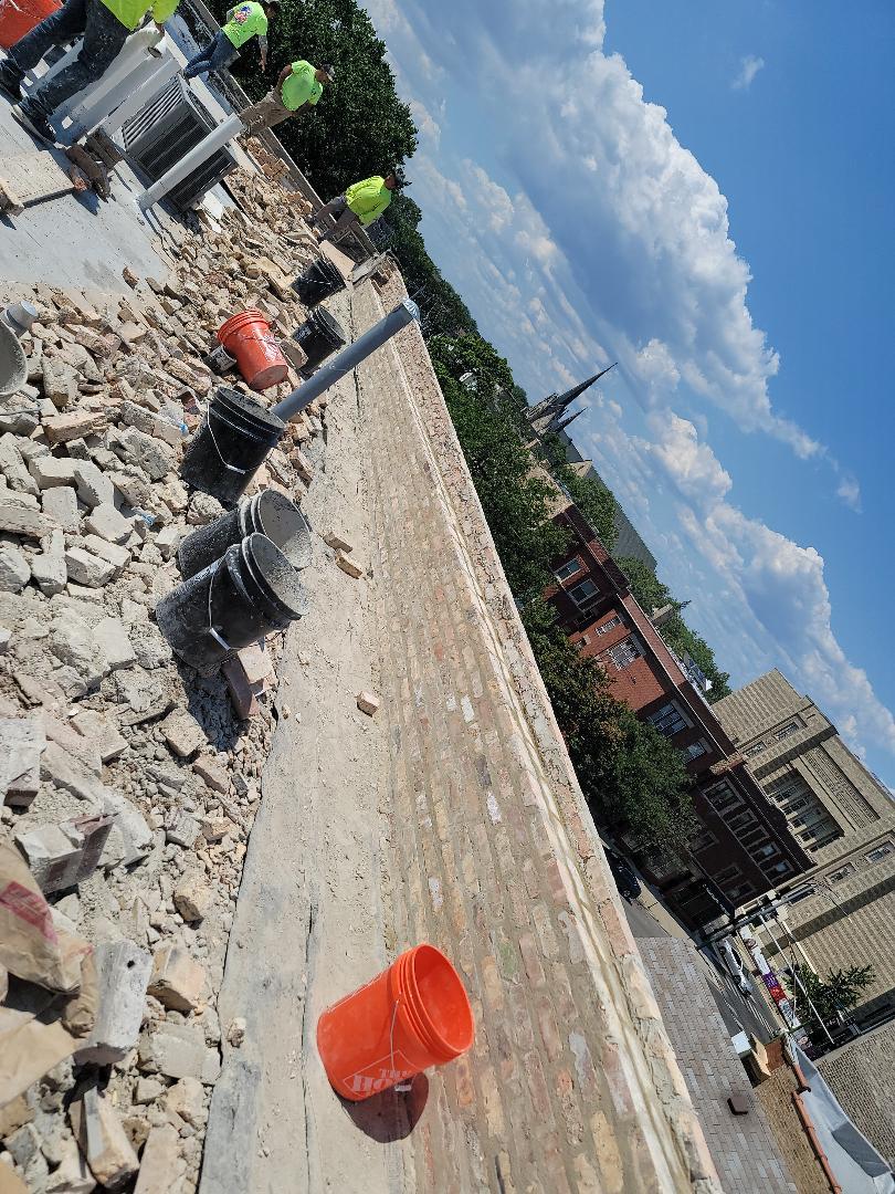 Rebuild new parapet walls and caulk call NSBWfor any masonry needs