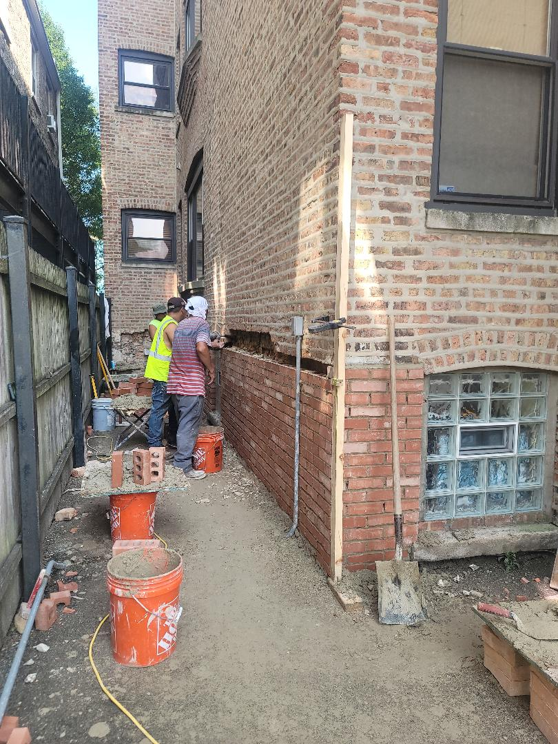 Brick replacement and Tuck pointing by North Shore Brick Work.