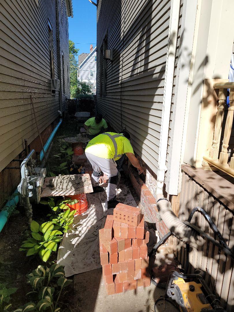 Laying bricks call NSBW for any masonry repairs