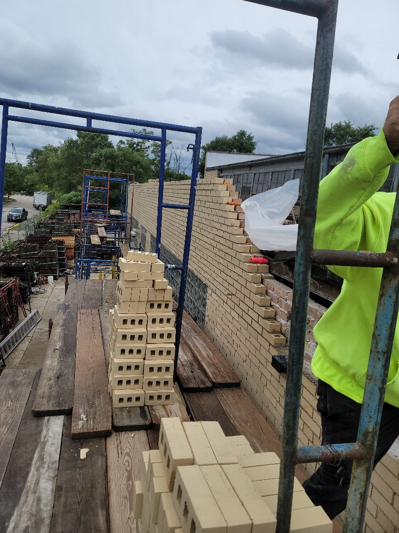 Parapet wall Rebuild for North Shore Bricks and Windows.