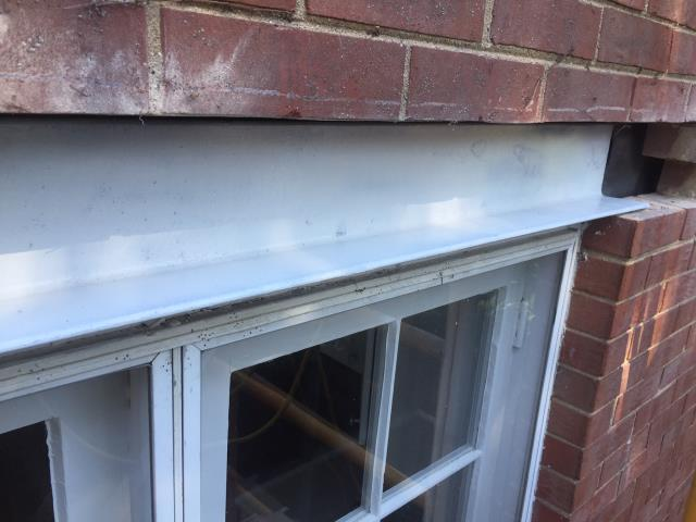Wilmette, IL - Spot grinding and tuckpointing and lintel flashing restoration and lintel repairs.
