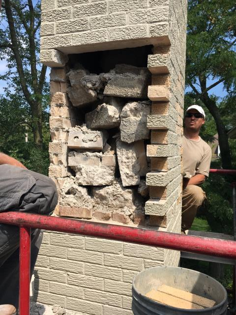 Northfield, IL - Major masonry and brick chimney rebuild was needed because last company left all this debris in the chimney.  This caused major water and drainage issues which were causing the bricks to deteriorate prematurely.  A liner was broken as well.