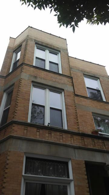Chicago, IL - Remove and replace the outer layer of bricks at parapet walls of the North, South, and East sides of building. Brick must match and be of quality.   Install all required flashings, ties, weeps as needed.  Install new copings to replace all defective/broken/non-usable copings on top of wall.  Inspect and repair top and bottom of balcony and pillars, including repairing limestone cracks.  Repair ground level cement stoop corners, front, and sides. Includes drilling out 2 iron posts, replacing and securing iron, and replacing both cement corners.  Address any cosmetic issues with the front stoop.  Set scaffold and inspect brickwork on Front Elevation. Spot tuckpointing as need on all open, missing, or deteriorated joints. Front and both sides.  Repair brick inside building, 2 small walls in basement.  Haul away all debris.  Permits included.