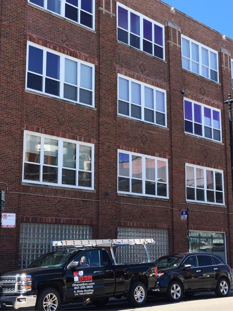 Chicago, IL - Commercial building masonry project we estimated and performed involving tuck-pointing, brick replacement, wall rebuild, limestone copping stone replacement & parapet cap reset.