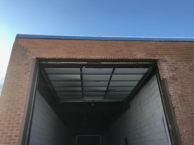 Elk Grove Village, IL - Commercial property in the western subs of Chicago called in need of repairs to the masonry around their garage door after semi trucks missing the opening and hitting the brick wall.