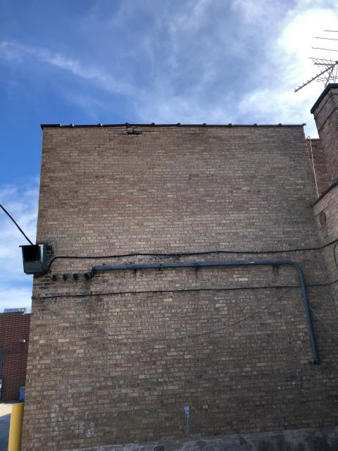 Rolling Meadows, IL - Northwest suburbs commercial building in need of masonry repairs. Missing bricks, grinding & tuckpointing for a large nationwide property management company.