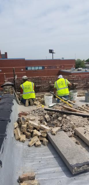 Chicago, IL - Interior courses of brickwork removed from parapet wall and ready to rebuild for a condo building in Chicago.