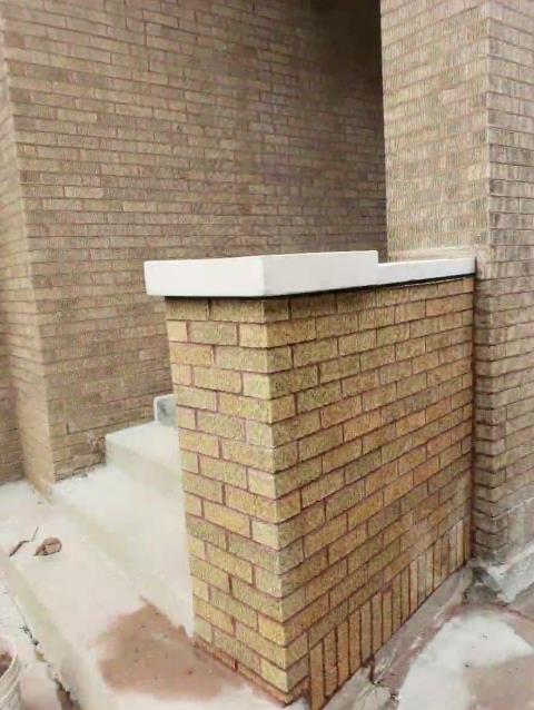 Chicago, IL - Completed this rebuild of the brick wall along the front steps of this beautiful home in Chicago.