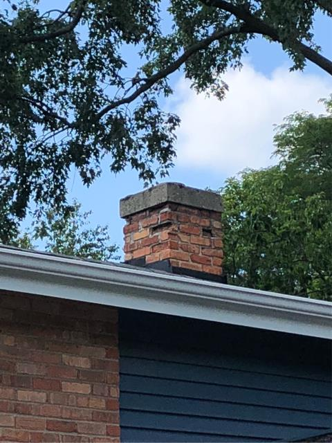 Palatine, IL - Another happy customer!! Deconstructed chimney down to roof line and rebuilt with a new concrete cap and rain cap.