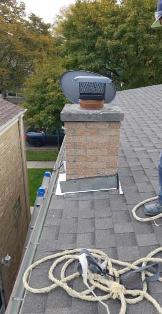 New flashing and rain cap installed on the chimney on this lovely Chicago home.