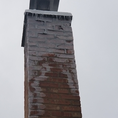 Niles, IL - Evaluating a chimney in need of grinding and tuckpointing in Niles, IL.