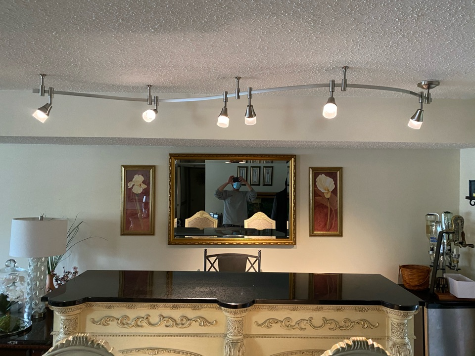 Install flexible track light with new wiring and dimmer. Also install exterior lights and repair GFCI not working.