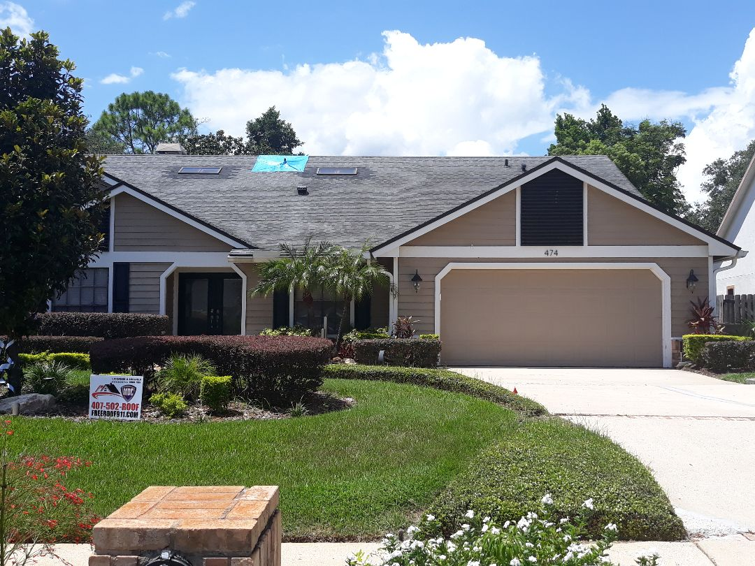 Longwood, FL - Reroof and skylight win for home owner