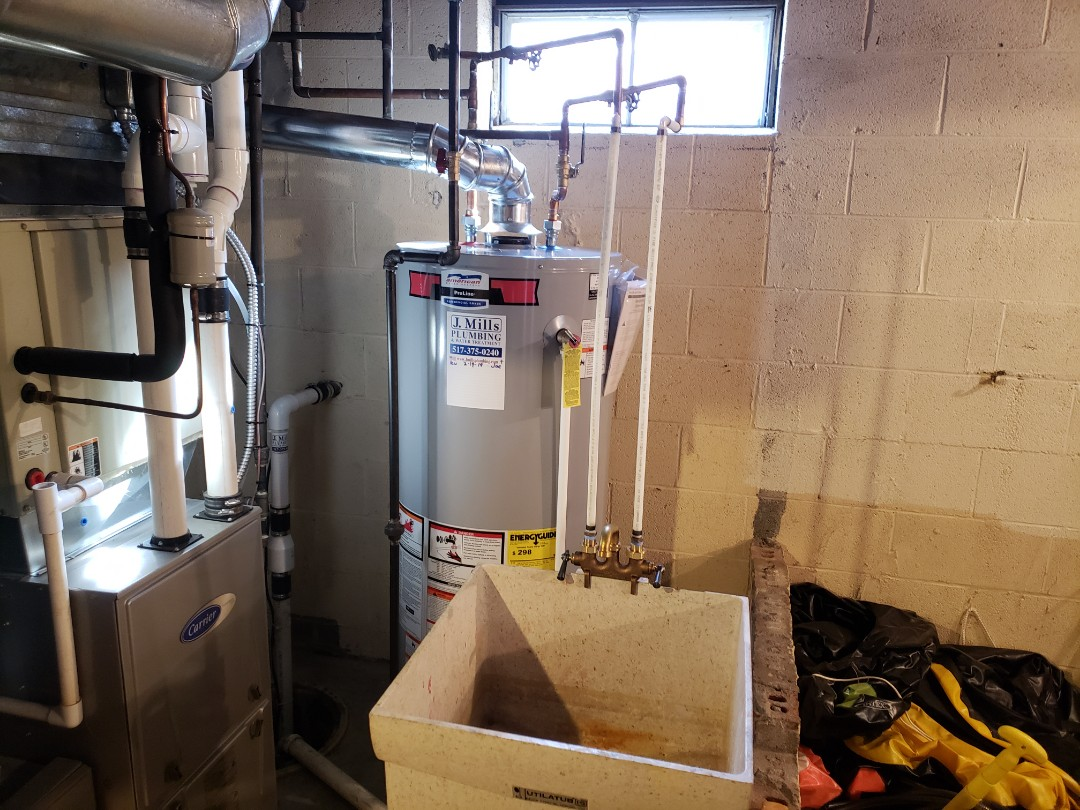 Brighton, MI - New water heater install Remove old leaking water heater Plumber needed best plumber Brighton good reviews Nee sump pump new laundry tub faucet