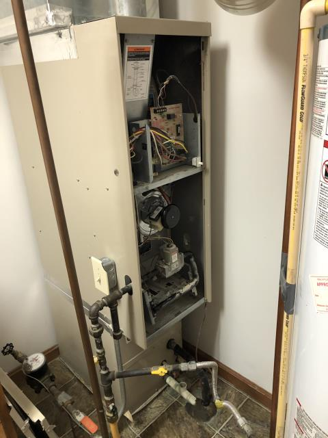 Sunbury, OH - Found the 2001 Lennox system coding roll out safety tripped. Jumped out safety and system still would code open safety. Pulled board and found several burnt contacts. Found corrosion and hot spots on heat exchanger.