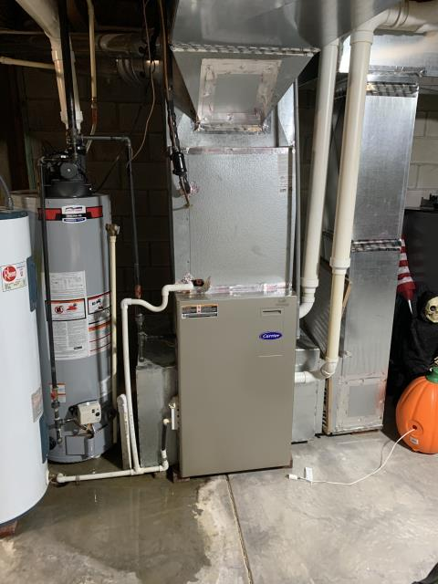 Hilliard, OH - Found water on floor remove service panel for evaporator coil and found drain pan completely full of condensate. Cleared trap and system and flushed multiple times with water to ensure system is draining properly.