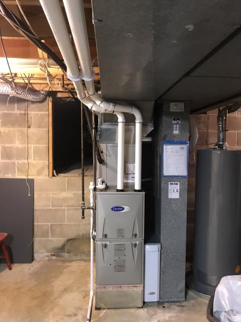 Columbus, OH - I replaced the clamp and reinstalled the drain line on a Carrier furnace system.