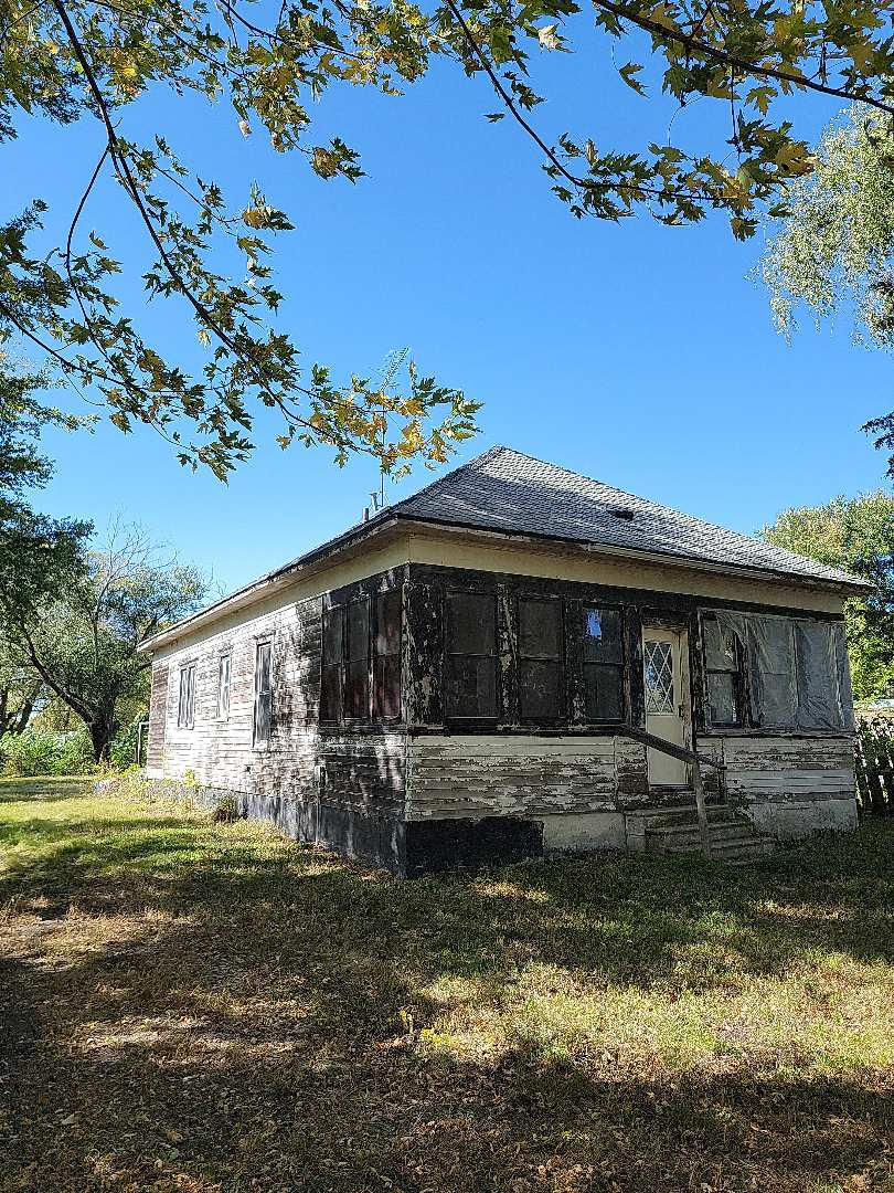 Silver Creek, NE - Giving a bid for a fixer upper