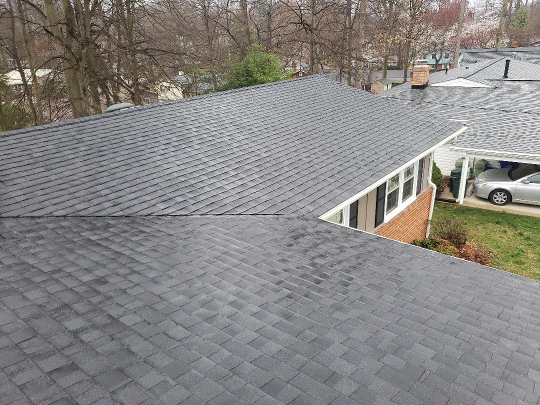 Rockville, MD - New architectural replacement roof, lifetime certified warranty, new K style seamless gutters, and gutter guards. Color of shingles, Charcoal Black.