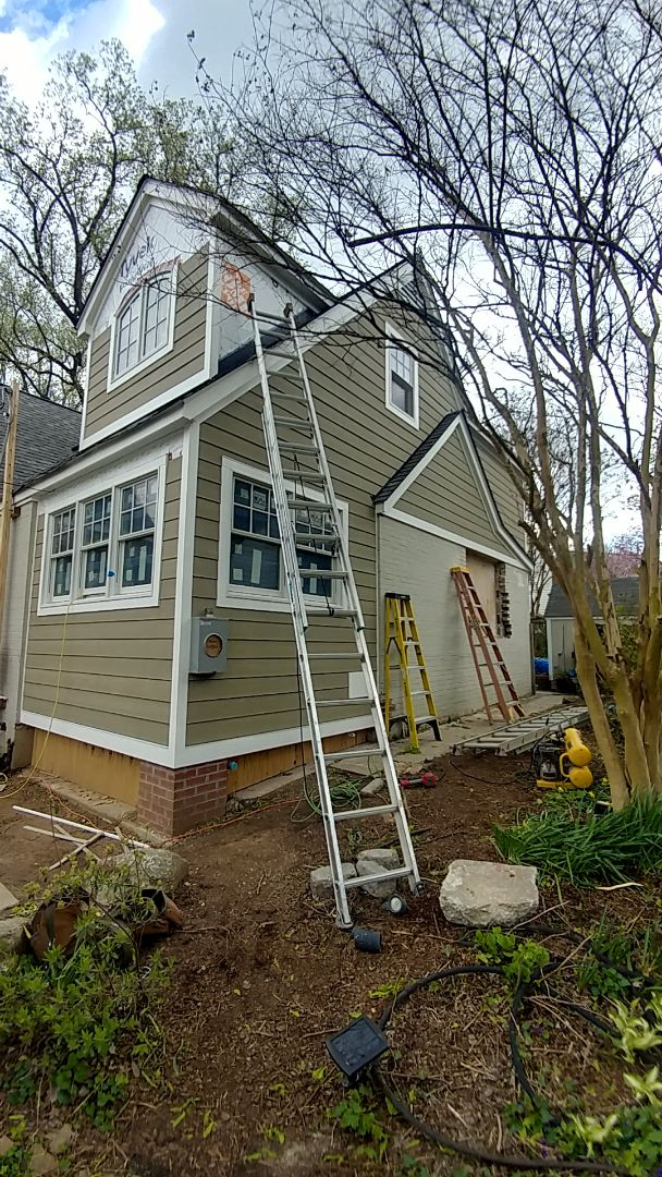 Silver Spring, MD - New Andersen Series 400 windows, PVC trim, James Hardie siding and Certainteed Landmark shingles on an addition in Silver Spring.
