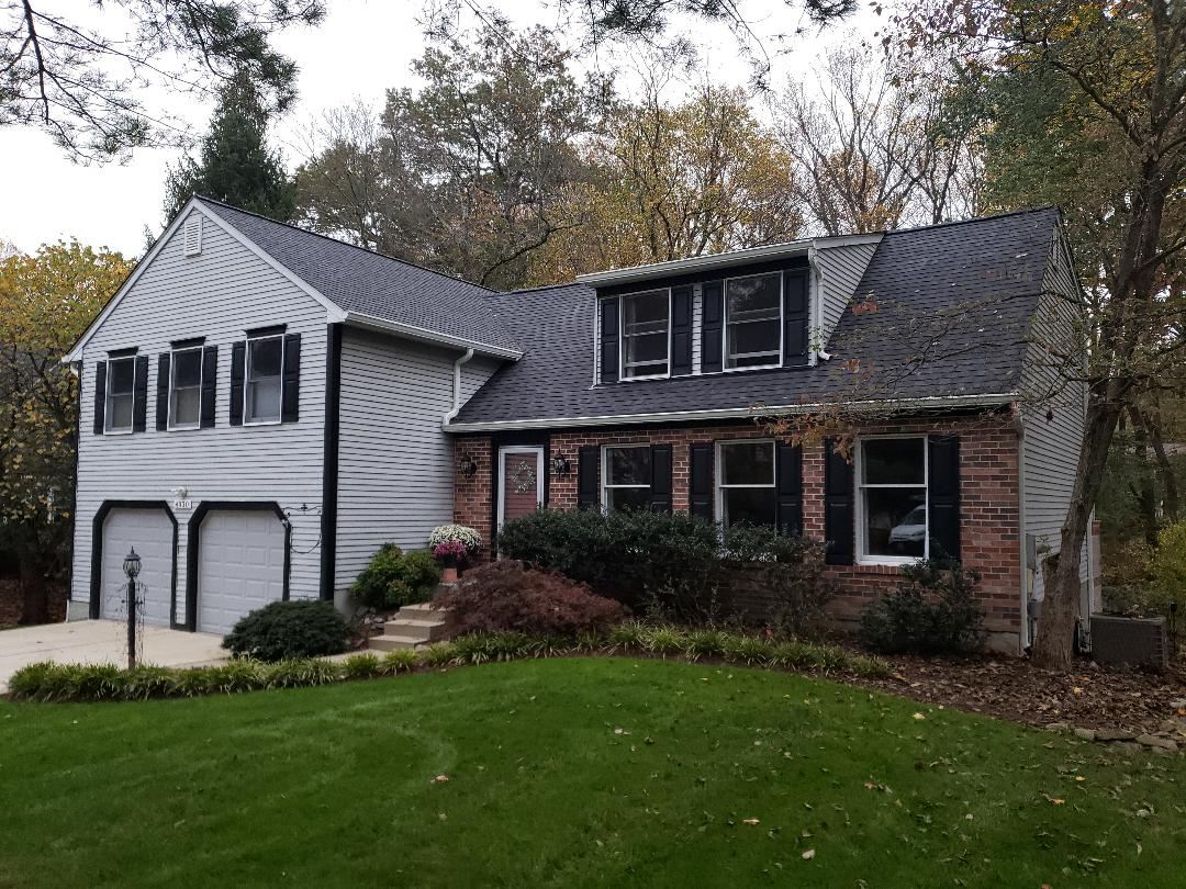 "Ellicott City, MD - New 6"" seamless gutters and certified shingle master landmark architectural shingles in moire black"