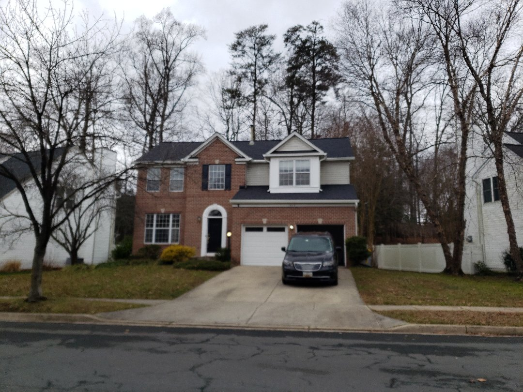 "Crofton, MD - New seamless 6"" gutters and 5 star certified certainteed architectural replacement roof shingles in moire black. Crofton, MD"