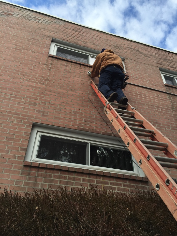 Folcroft, PA - Installing new security lights with motion detectors.