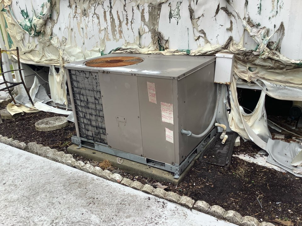 Coconut Creek, FL - AC Maintenance Call. Perform routine maintenance per maintenance agreement on air conditioning system. Also repair burnt wires caused from fire next door.