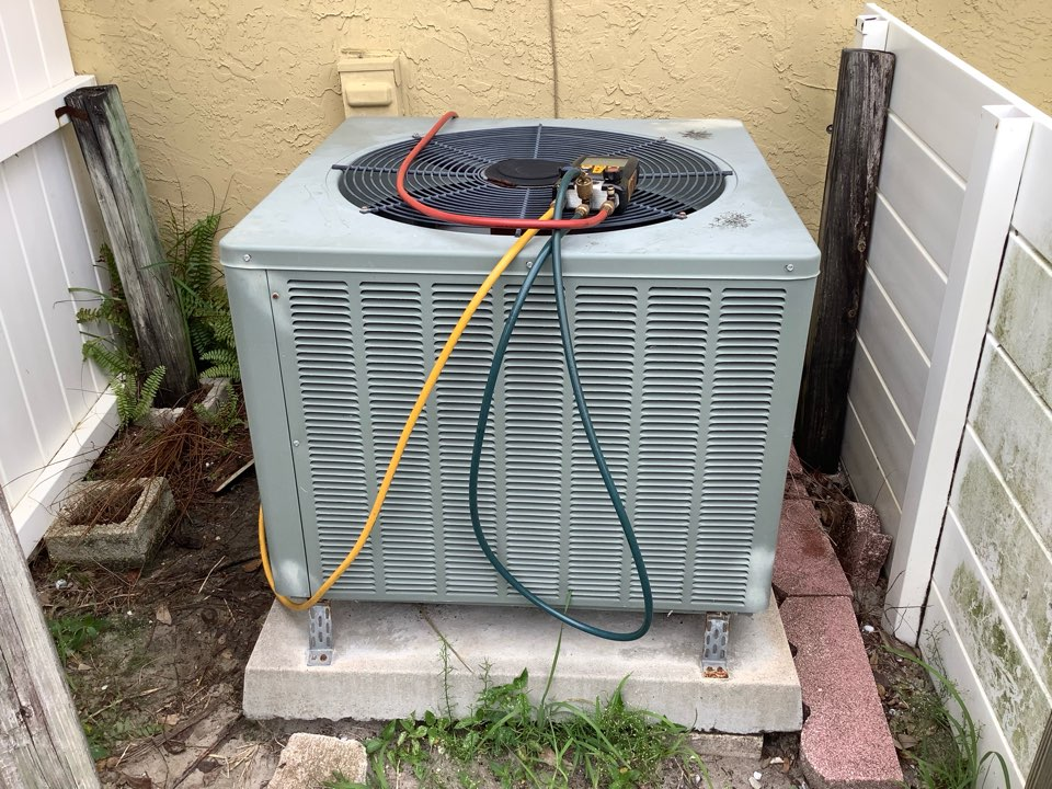 Oakland Park, FL - AC Service Call. Evaluate system to find condenser coils had lint on one side. Rinse condenser coils and check refrigerant charge. Recommend replacing air conditioning system.