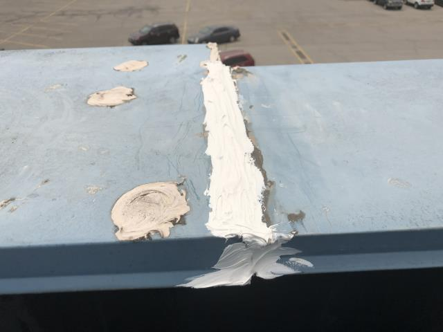 Tulsa, OK - Repaired leak above Metro Surfaces from metal cap seams separating, removed old sealant, cleaned ,prepped, and sealed 2 seams