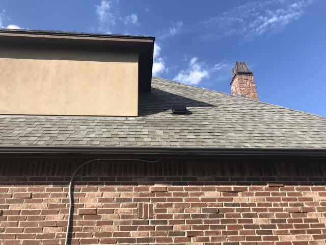 Broken Arrow, OK - Replaced damaged shingles, replaced dryer vent cap, sealed down flashing under window