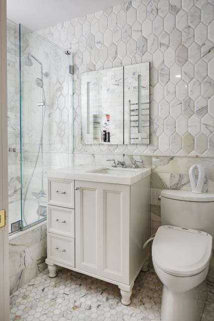 New York, NY - Neutral and traditional, with light installed glass. Yes!  This is a NYC bathroom. Lower East Side Manhattan.
