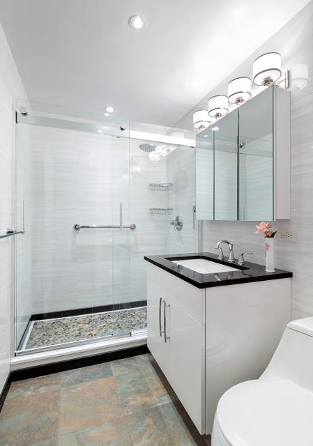 New York, NY - Upper East Side Basement bathroom full renovation. We were tasked to turn a dark moist basement water closet and make it bright and functional.