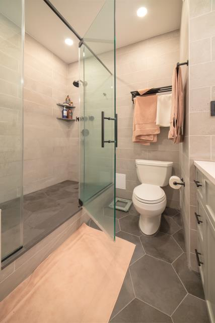 New York, NY - Walk-in shower and magnificent glass doors.