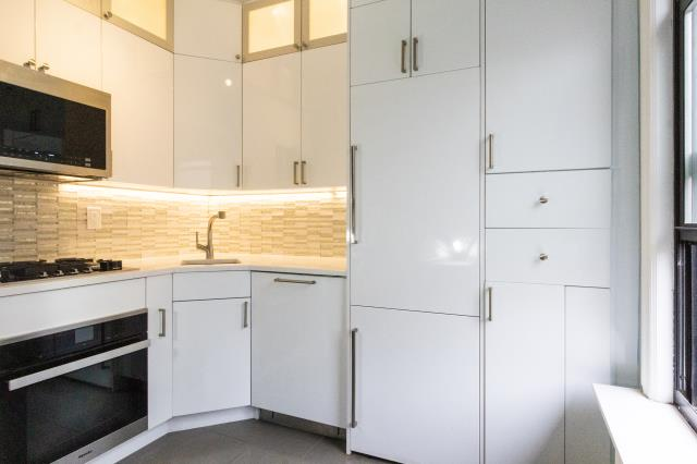 New York, NY - Small spaces / Big Design ideas - Gramercy Kitchen transformation, for this small kitchen; In panel fridge and lots of cabinets.
