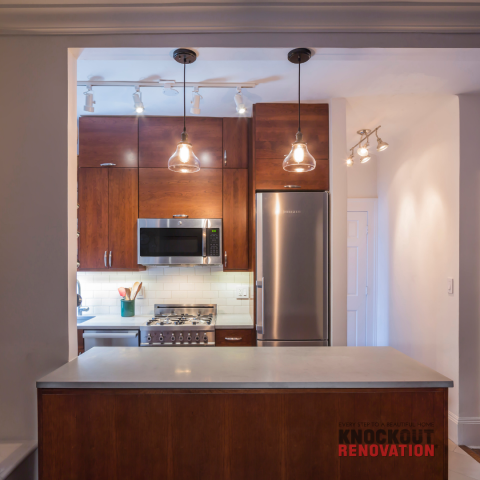 New York, NY - Upper Westside Condo Kitchen Renovation. Semi-Custom cabinet and counter depth refrigerator helps small kitchen spaces feel neat and spacious.