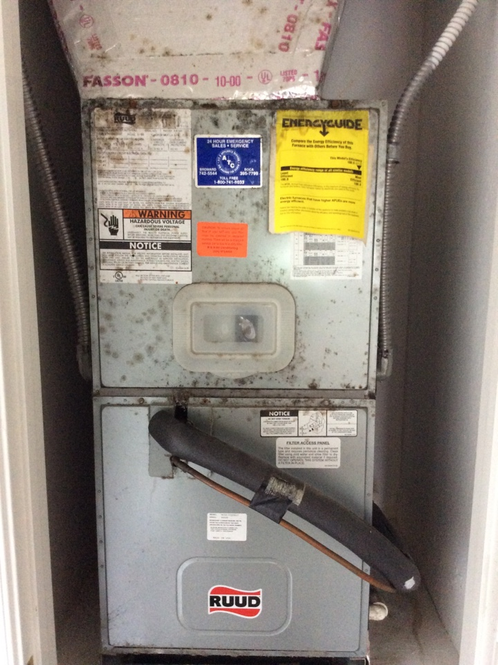 Weston, FL - Repairing cracked drain line under floor. Cleaning and sanitizing blower wheel, evaporator coil and exterior of air handler cabinet with Vital Oxide to remove and kill visible mold growth.