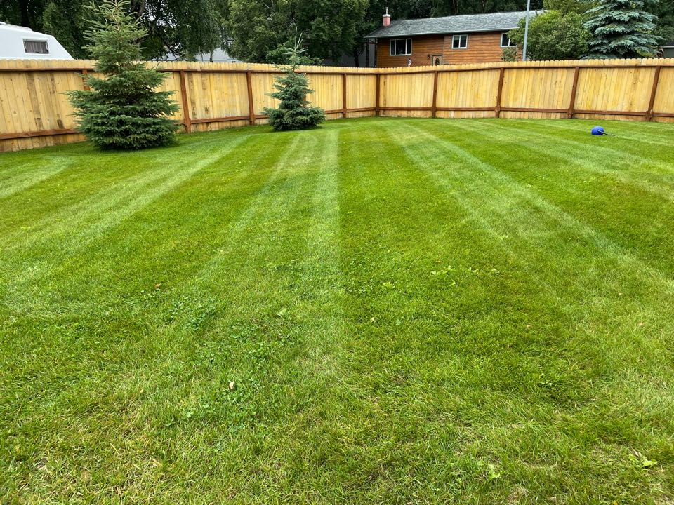 Anchorage, AK - The rainy season means cleaning the decks more, but the beautiful lawns are always worth it!