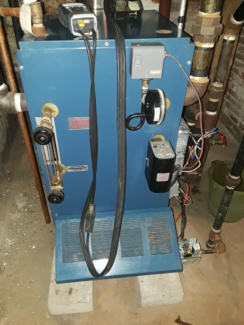 Clean and check Utica gas steam boiler