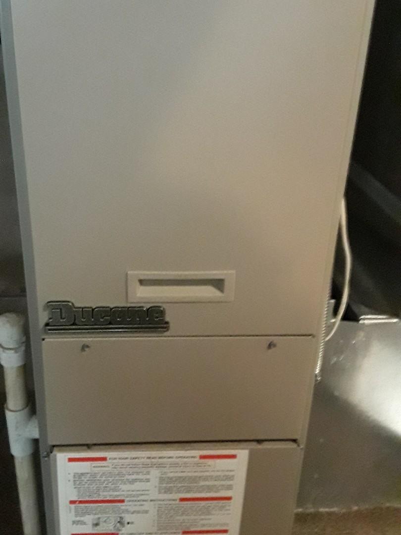 Repair on a Ducane gas heating unit